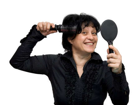 woman making her hair studio isolated photo