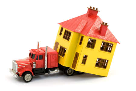 toy truck: moving a house with a truck studio isolated