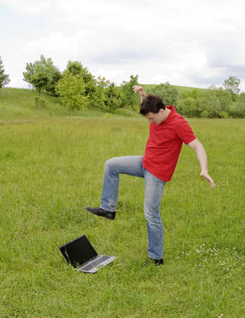 man about to step on laptop photo