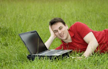 man woriking on laptop outdoor photo