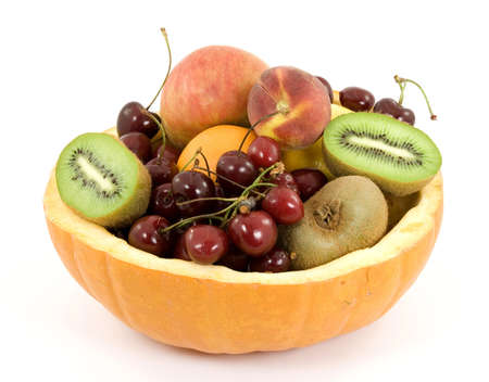 mixed fruit salad in pumpkin dish studio isolated photo