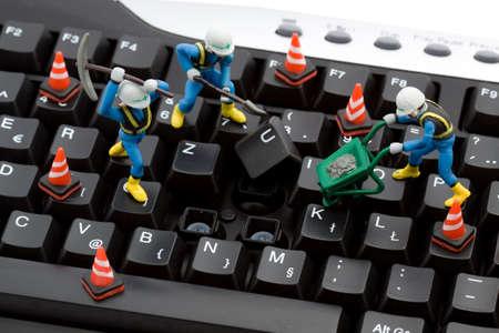 computer repair concept - workers repairing keyboard Stock Photo - 3862397