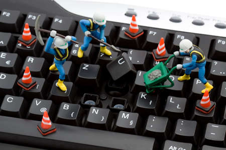 figurines: computer repair concept - workers repairing keyboard