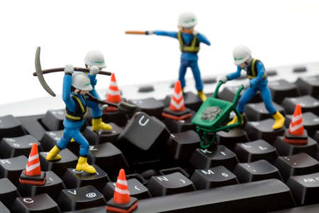 computer repair concept - workers repairing keyboard