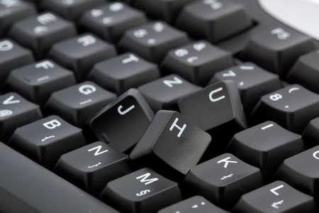 broken black computer keyboard isolated Stock Photo