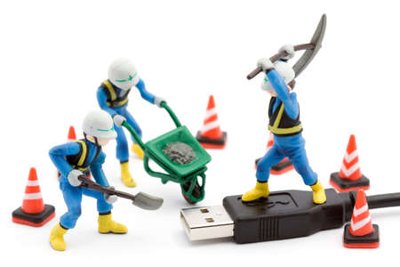 repaired: computer repair concept - usb cable repaired by workers isolated Stock Photo