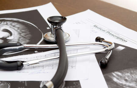 medical theme - doctors desk with documents and stethoscope photo