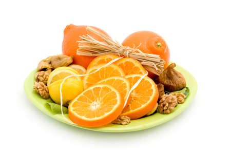 oranges fruit in a plate studio isolated photo