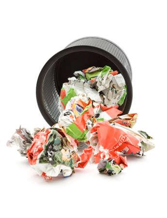 spamming: bin full of paper trash studio isolated