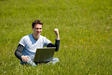 man with laptop outside working Stock Photo - 4803553