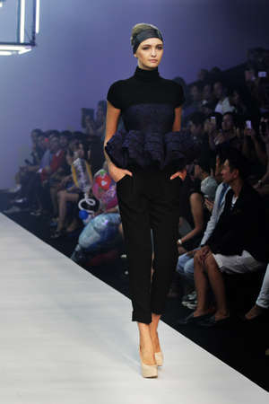 paragon: A female model walks on the ramp during Bangkok International Fashion Week 2013,Thailand - Nov 10,2013: All clothes created by FlyNow at Siam Paragon Shopping Mall