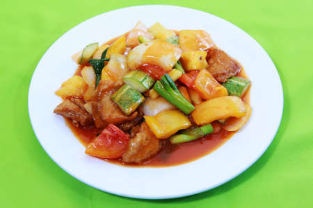 sauce dish: Sauted mixed vegetables and pork with sweet sour tomato sauce.