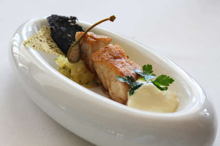 grouper: Pan Fried grouper fillet and crushed potatoes emulsion with capers Stock Photo