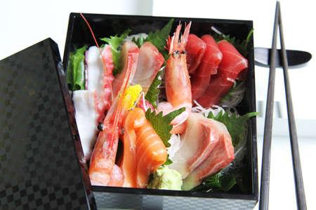 tekka: Fresh raw seafood or Sashimi on rice in a bento box Stock Photo