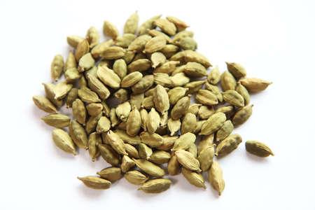 cardamon: Iranian Cardamon pod seeds close up isolated on white background