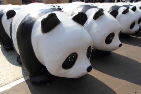 wwf: Bangkok, Thailand  March 8, 2016: A cute flash mob of 1,600 Paper Mache pandas a campaign showcase at Bangkok by WWF exhibition by  WWF and French artist Paulo Grangeon to promote environmental preservation at BTS Chong Nonsi