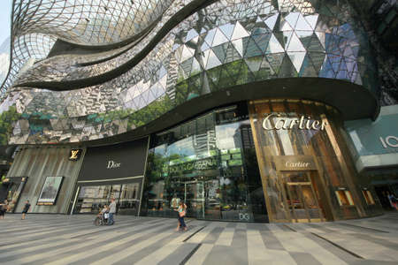 ion: SINGAPORE - September 22, 2014 : Day view of ION Orchard shopping mall. The Media Facade is a multi-sensory canvas media wall made with cutting-edge   technology.