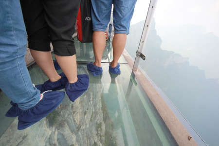 A Perfect Instrument to Terrify People ,Glass Bridge sky walk at   Tianmenshan Tianmen Mountain China Фото со стока