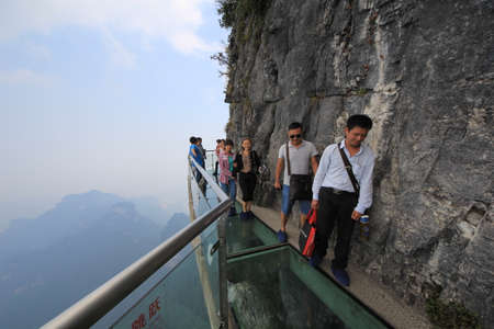 terrify: China - September 24,2013 : A Perfect Instrument to Terrify People ,Glass Bridge sky walk at Tianmenshan Tianmen Mountain China ,a UNESCO World Heritage Site