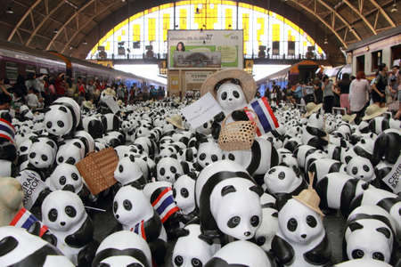 wwf: Bangkok, Thailand March 13, 2016: A flash mob of 1,600 Paper Mache pandas a campaign showcase by  WWF and French artist Paulo Grangeon to promote environmental preservation at Hualumpong TrainStation Editorial