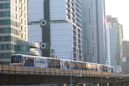Bangkok, Thailand : March 12, 2016 : The Bangkok Mass Transit   System BTS or Skytrain runs through the city center Chong Nonsi    Station, Silom line(in bound) with Bangkok skyscraper in   background Sajtókép