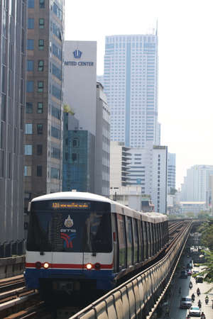 Bangkok, Thailand : March 14, 2016 : The Bangkok Mass Transit System BTS or Skytrain runs through the city center Saladaeng Station, Silom line(in bound) with Bangkok skyscraper in background