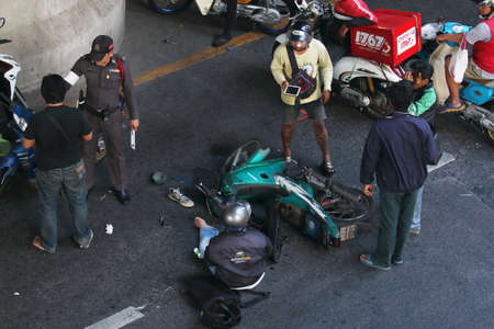 Bangkok, Thailand March 13, 2016 : Crash Accident Between two   Motorcycles at intersection Sathorn Road.