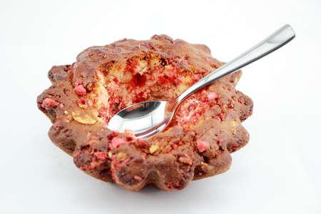 praline: Eating Pink praline cake isolated on white background
