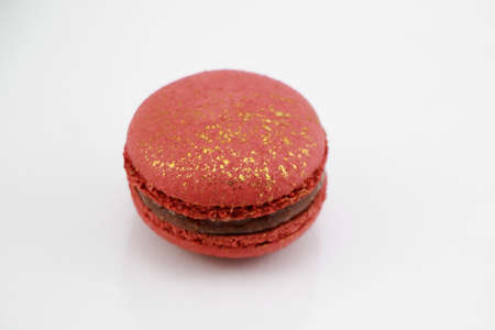 impressive: Top view of Impressive a gold-red, large-sized patterned macaroon Stock Photo