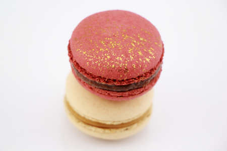 raspberry jelly: Stack of Impressive a gold-red and A pearly white, large-sized patterned macaron filled with mild sweet lychee ganache , raspberry jelly and chocolate packaged in a box