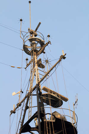 deck cannon: Old battleship deck ,radar navigation system and communication tower Stock Photo