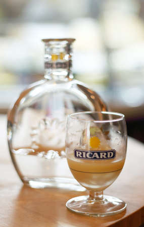 dilute: A glass of Ricard added ice and A bottle of water at El Mercado - The Chefs Market ,Bangkok. Its the national drink of France, but pastis is under pressure