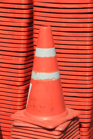 traffic   cones: Stack of orange traffic cones