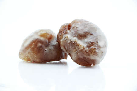 marron: Marron glace or Candied Chestnuts Are A Classic Turkish Confection Isolated on a white background Stock Photo