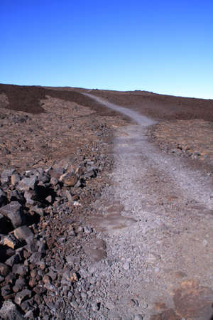scenic drive: Mauna Loa Scenic Drive is a 17-mile (one way) roughly paved narrow road, climbing up to Mauna Loa, the largest volcano on Earth Stock Photo