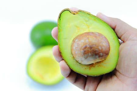 Fresh Avocado Halves On Hand Reklamní fotografie