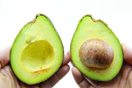 Fresh Avocado Halves On Hands