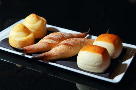 Breads on a plate isolated on black background Reklamní fotografie