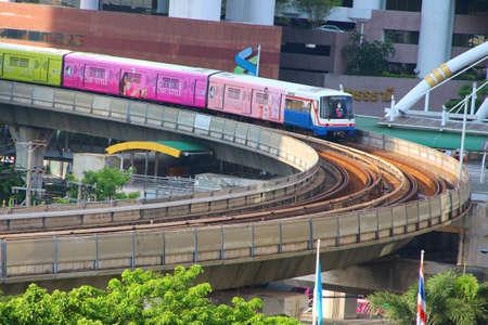 Bangkok, Thailand : October 27, 2016 : The Bangkok Mass Transit System BTS or Skytrain Goes Round Cornering through the city center Chongnonsi Station, Silom line (out bound)
