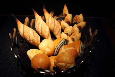 Exotic Bread Basket isolated on black background (Natural Lighting)