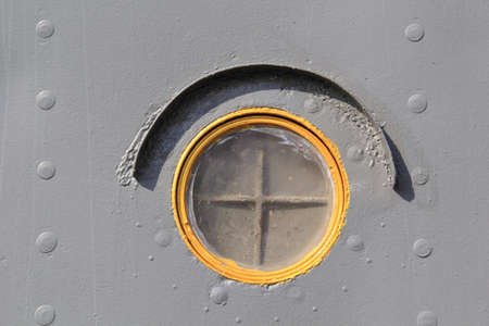 Close up of Old ship rusty porthole or steam punk submarine or military ship window Reklamní fotografie