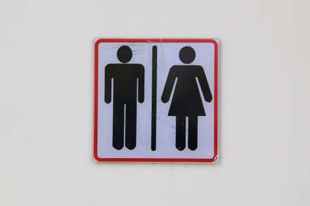 Men and woman toilet signs on a wall