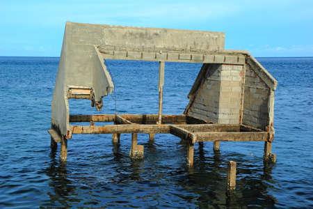 Ruined and abandoned house in the Sea of ChongSamaeSarn a fishing village Sattahib ,Thailand