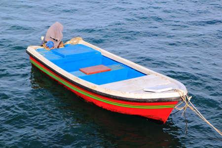 Traditional Moored fishing boats in quiet port on the Sea of ChongSamaeSarn a fishing village Sattahib ,Thailand