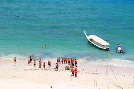 Luk Lom Beach on Samae Sarn Island. The beach is visited by liveaboard dive boats and speedboats on scuba diving and snorkeling safaris at Sattahip, Thailand.