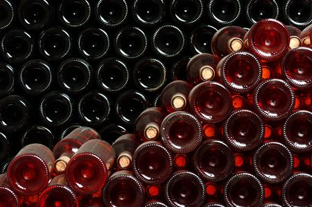 Bottles of wine stocked in a wine cellar. Stock Photo - 676772