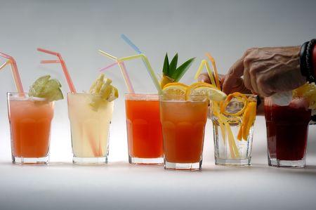 stirred: A barman arranges colorful vodka cocktails.