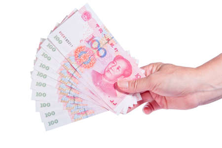 rmb: hand holding a lot of one hundred dollars notes of rmb isolated on white