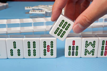 mahjong: touch a nice mahjong tiles in a game Stock Photo