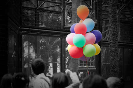 colorful ballons on black and white crowd photo